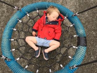 Jack asleep on the swing